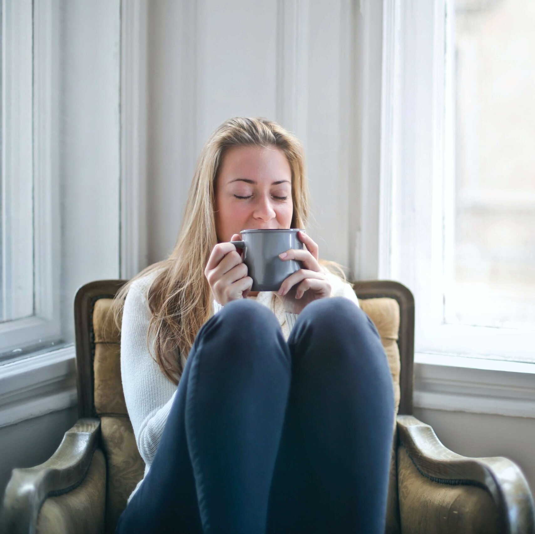 mental health in the workplace young woman relaxed driking a cup of tea